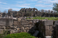 Antique Side, Turkey. Image shows details of Antique Side, Turkey. Image is dominated by ruins in the front and in the middle. Sky is blue and light cloudy Stock Photos