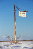 Antique sign. Antiques sign hanging from a rusted metal pole Royalty Free Stock Photography