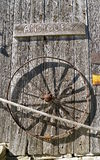 Antique sign and metal wheel Royalty Free Stock Images