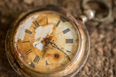 Antique silver broken pocket watch. Antique silver broken pocket watch on wooden background Stock Images
