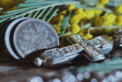 Antique silver coins with the double-headed eagle and an Orthodox cross. Vintage still life Royalty Free Stock Images