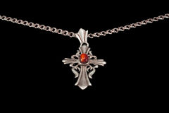 Antique silver cross on a chain Stock Photography