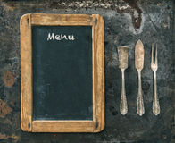 Antique silver cutlery and blackboard. Vintage style. Food conce Stock Photos