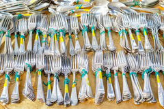 Antique silver cutlery on display at Old Spitalfields Market. In London Royalty Free Stock Image