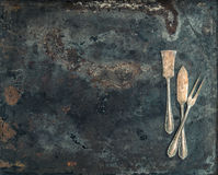 Antique silver cutlery on rustic metal background. Vintage table Stock Photo