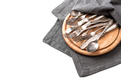 Antique silver cutlery on rustic wooden kitchen desk. Kitchen ut Stock Photo