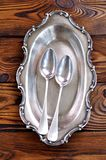 Antique silver cutlery on a wooden table. spoons. Royalty Free Stock Photos