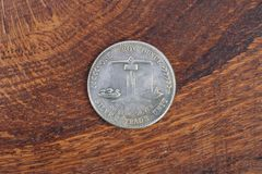 Antique silver dollar. On wooden background Royalty Free Stock Image