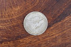 Antique silver dollar. On wooden background Stock Image