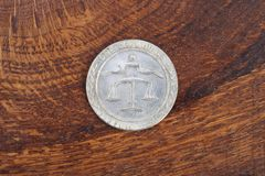 Antique silver dollar. On wooden background Stock Photo