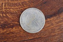 Antique silver dollar. On wooden background Stock Photos