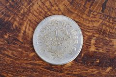 Antique silver dollar. On wooden background Royalty Free Stock Photo