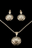 Antique silver earrings and pendant on a chain Stock Photo