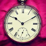 Antique silver fob watch on pink cloth Stock Images