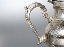 Antique silver jug detail Stock Photography