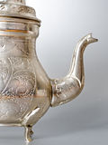 Antique silver jug detail Stock Image