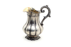 Antique silver jug . Antique silver jug  on a white background Royalty Free Stock Images