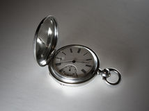 Antique silver pocket watch. Black and white view of open antique silver pocket watch with studio background royalty free stock images