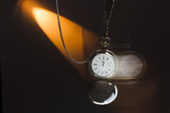 Antique silver pocket watch on a chain Stock Image