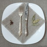 Antique Silver Tableware. On Sacking Napkin over Plate Stock Photography