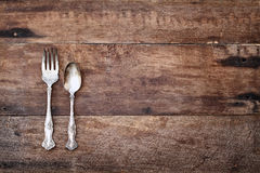 Antique Silverware over Rustic Wooden Background Stock Image