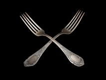 Antique silverware table  fork silver over black Stock Image