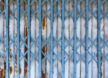 Antique slide steel locked shutter door Stock Image