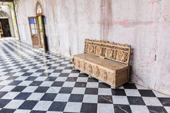 Antique sofa against old stucco background Royalty Free Stock Photo