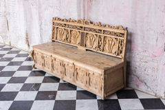 Antique sofa against old stucco background Stock Images