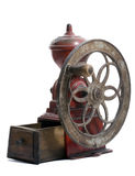 Antique Spanish Coffee Grinder. Red cast iron, antique Spanish Coffee Grinder with side wheel and wooden collection tray stock photography