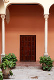 Antique Spanish door in old patio Royalty Free Stock Images