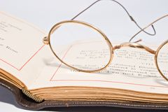 Antique spectacles on old open book Royalty Free Stock Image