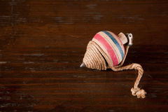 Antique spinning top. On a brown wooden background Stock Image