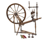 Antique spinning wheel with yarn and bobbins isolated on white Stock Photography