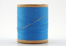 Antique Spool of Thread. With Needle royalty free stock photography