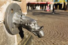 Antique spout of a drinking fountain in Cologne. Antique spout of a drinking fountain on the Old Market Square in Cologne, Germany Stock Photos