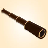Antique spyglass brown on a light yellow background. Royalty Free Stock Images