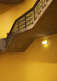 Antique Stairwell. Interior, yellow wall royalty free stock images