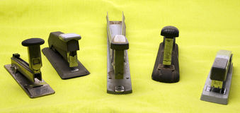 Antique staplers office supply Stock Images