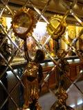 Antique statue. Clock, mirrors Stock Photo