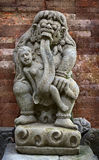 Antique statue of child-eating Rangda. Indonesia, Bali. Royalty Free Stock Photo