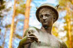 Antique statue of Hermes in the park stock images
