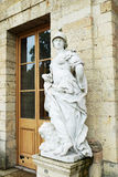 Antique statue next to Palace in Gatchina Stock Photo