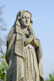 Antique statue of the Virgin Mary praying religion, faith, holy. Sin Royalty Free Stock Photo