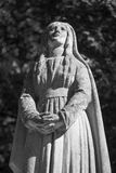 Antique statue of the Virgin Mary praying religion, faith, holy Stock Photo