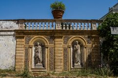 Antique statues in the fence with steps in the Villa Doria-Pamphili in Rome, Italy. Antique statues in the fence with steps in the Villa Doria-Pamphili in Rome stock photo