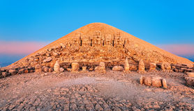 Antique statues on Nemrut mountain, Turkey. Statues on the summit of Mount Nemrut in Turkey on sunrise Royalty Free Stock Image