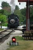 Antique steam locomotive. Old steam locomotive leaving the station. Greenfield Village, Michigan, USA Stock Photography
