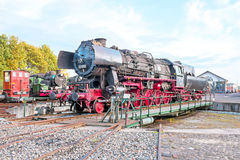 Antique steam locomotive in depot Stock Photo