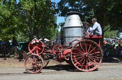 An Antique steam tractor, Brooks, Oregon. An antique steam tractor rolls down the road at Antique Powerland for an admiring crowd near Brooks, Oregon on a summer Stock Image
